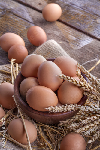 eggs in a wooden bowl on a linen canvas