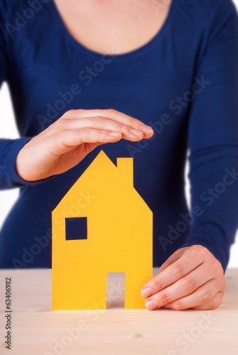 Woman Protecting House