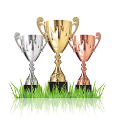 Champion trophies green on grass. Isolated on white
