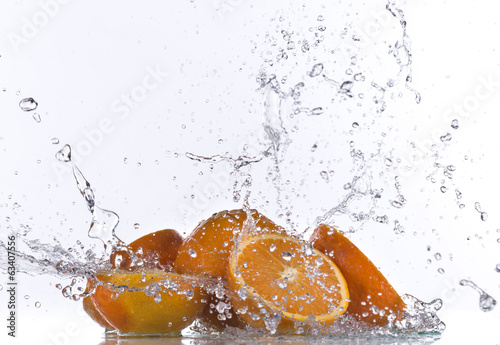 canvas print picture Oranges with water splash