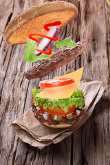 delicious hamburger on wood