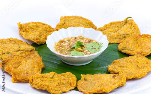 Fried fish patty on white background