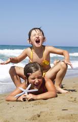 happy girls on the beach