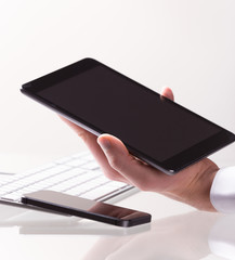 Hand touching digital tablet