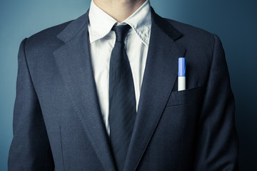 Businessman with a marker in front pocket