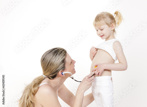 little girl with her mother and stethoscope