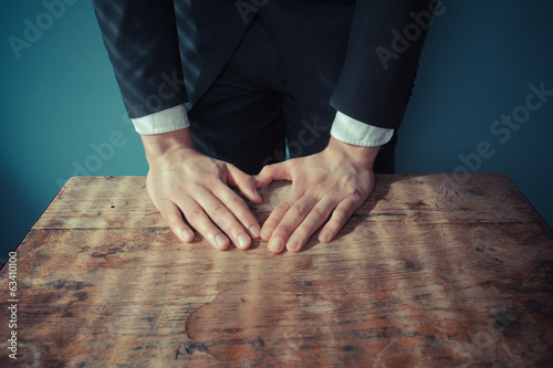 Businesman standing behind desk
