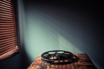 Film reel on table