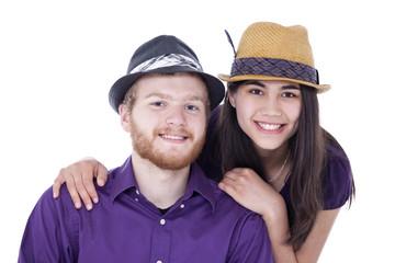 Happy young interracial couple in purple shirts, studio shot