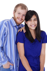 Happy young interracial couple in blue, early twenties or late t
