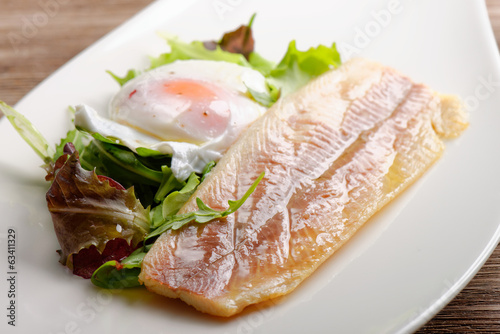 Steamed fish fillet with egg, salad and fresh herbs
