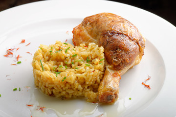 Roasted chicken legs or drumsticks with cooked Saffron rice