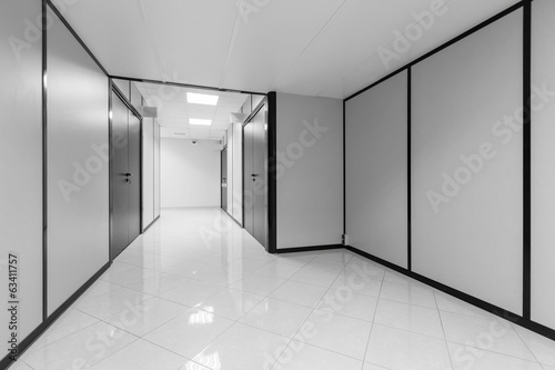 Abstract empty office interior with white walls and black decor