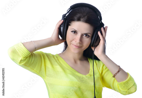 the girl with earphones listens to music