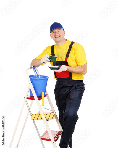 Worker on ladder with cup of tea