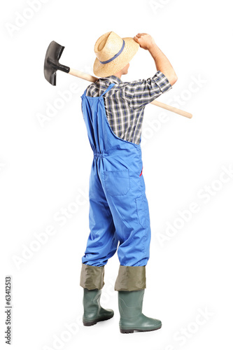 Male agricultural worker holding a shovel