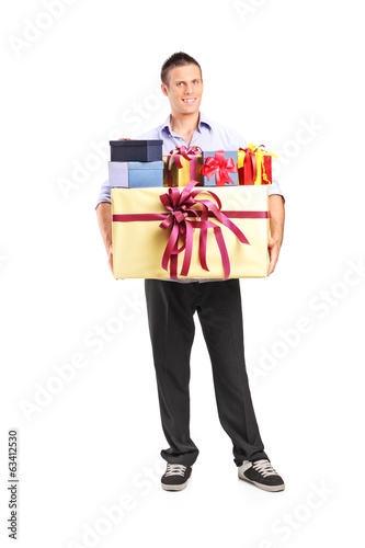 Man holding a bunch of presents