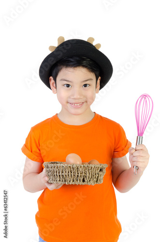 Asian cute boy with Egg on white background .