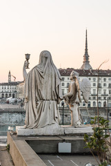 Statue with the possible Santo Graal looking toward Turin.