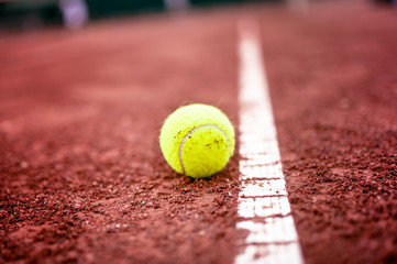 close-up of tennis ball on the clay court