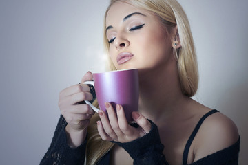 Beautiful sexy woman drinking Coffee. Cup of tea. Hot drink