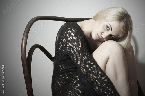 Beautiful blond Sexy woman in dress.Sad emotion.bench