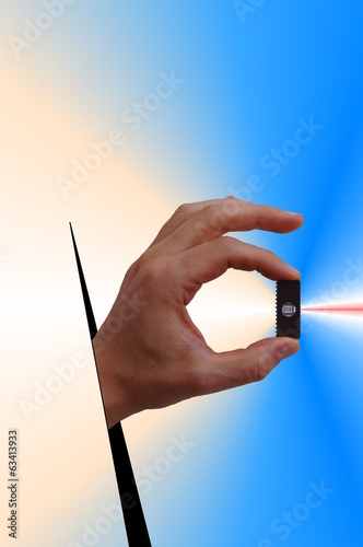 Windowed electronic integrated circuit between fingers.