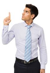 Attractive Businessman Pointing Upwards