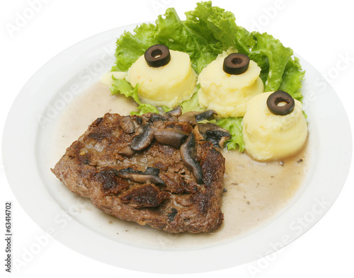 Grilled veal meat served with potato puree