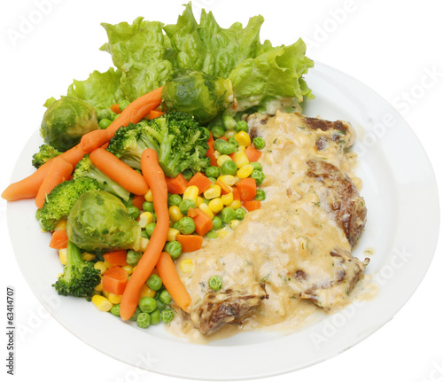 Grilled veal meat and fresh vegetables with mushrooms sauce
