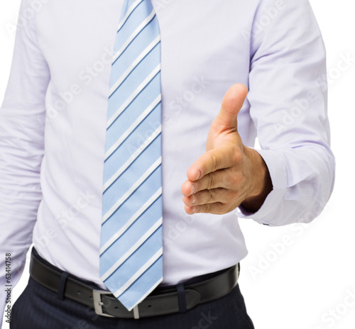 Midsection Of Businessman Offering Handshake