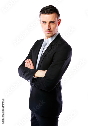 Businessman standing with arms folded over white background