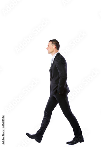 Side view portrait of a businessman walking