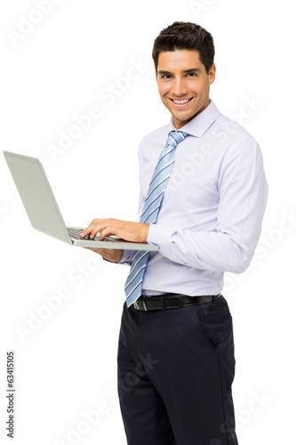 Portrait Of Confident Businessman With Laptop