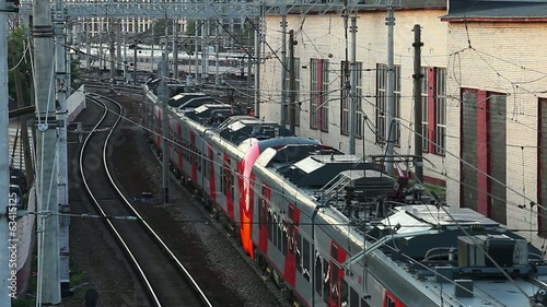 Passenger train in the web of electrical wires