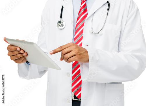 Midsection Of Doctor Using Digital Tablet