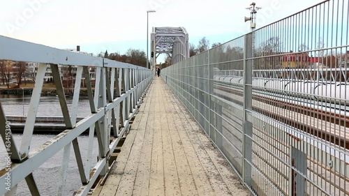 Fenced footpath on a railroad bridge