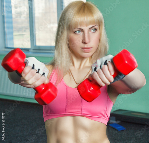 the girl is training in the gym