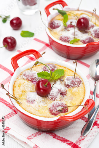 Clafoutis with cherries in red ramekin