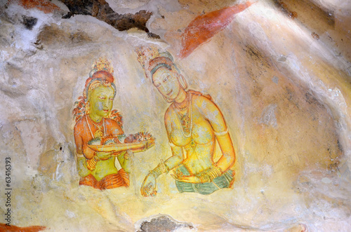 Sigiriya maiden with flowers painting on the rock