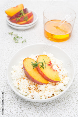 cottage cheese with honey, nuts and fresh peaches