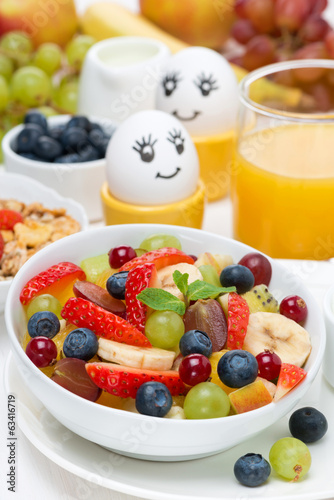 fresh fruit salad, cream and painted eggs for breakfast, vertica