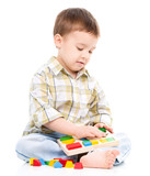 Little boy is playing with toys