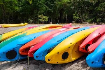 Bright kayaks on the beach. Colourful canoe