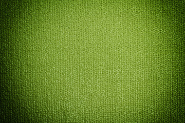 Detail view of yoga mat. Green background with vignette