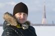 Man with ferret  in winter outdoor