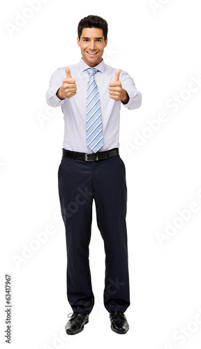 Portrait Of Businessman Gesturing Thumbs Up