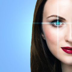 Young woman with lines scanning the eye. Medicine or biometric