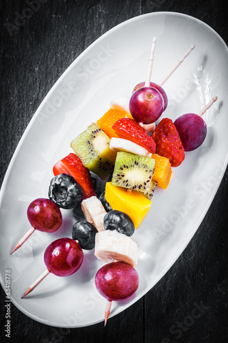 Fruit kebabs with berries and tropical fruit