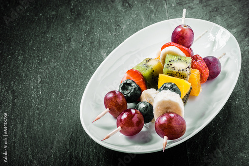 Colorful exotic fruit kebabs